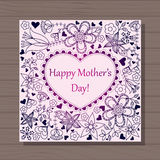 Happy mothers dat card with heart on wooden background Royalty Free Stock Image