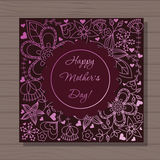 Happy mothers dat card on wooden background Royalty Free Stock Photography