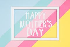 Happy Mothers Day abstract geometrical pastel blue, pink and yellow paper flat lay background. Minimalism greeting card. stock image