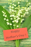 Happy mothers day and bouquet of delicate fresh lilies of the valley Stock Photos