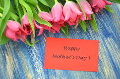 Happy mothers day and bouquet of gorgeous red tulips Royalty Free Stock Image