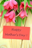 Happy mothers day and bouquet of gorgeous red tulips Stock Photos