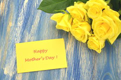 Happy mothers day and bouquet of gorgeous  yellow roses Stock Photography