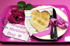 Pink Happy Mothers Day breakfast tray. Happy Mothers Day breakfast tray with pink rose and heart shape toast on polka dot tray. Vertical Stock Image