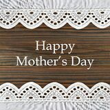 Happy Mothers Day card with lace borders on wooden background