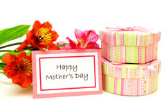 Happy Mother's Day. Happy Mothers Day Card among colorful flowers over white Stock Photo