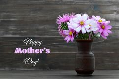 Happy Mothers Day card with flowers in the vase. Happy Mothers Day card with cosmos flowers in the vase stock images