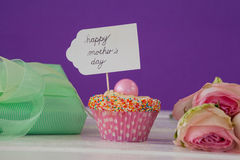 Happy mothers day card on cup cake Stock Image
