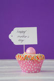 Happy mothers day card on cup cake Royalty Free Stock Image