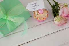 Happy mothers day card with cup cake and gift box Stock Photo