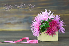 Happy Mothers Day card with flowers arranged in gift box Royalty Free Stock Photos