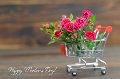 Happy Mothers Day card. With roses in shopping cart stock photo