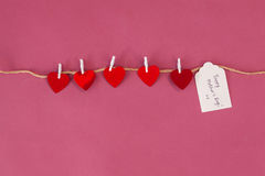 Happy mothers day card and red hearts hanging on rope Stock Photography