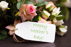 Happy mothers day card with rustic roses on wooden board stock image