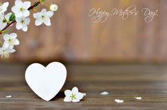 Happy Mothers Day card with spring flowers and decorative heart Stock Images