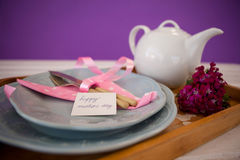 Happy mothers day card with teapot on wooden tray Stock Image