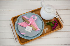 Happy mothers day card with teapot on wooden tray Stock Photography