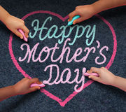 Happy Mothers Day Children. Drawing with chalk on asphalt a message of love for their loving parent and parenting appreciation for mom from a diverse community Stock Photos