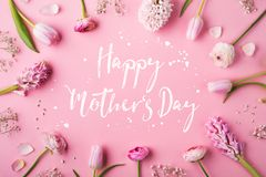 Happy mothers day composition. Flowers on white background. Studio shot. Stock Image