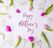 Happy mothers day composition. Flowers on white background. Studio shot. Stock Photo