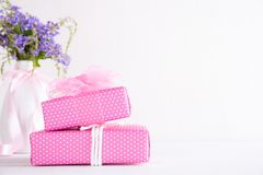 Happy mothers day concept. Gift box with purple flower on white wooden table background.  stock photo