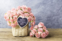 Happy mothers day concept of Paper carnation in weave basket Stock Photo