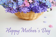 Happy Mothers Day. Mothers Day flowers. In basket royalty free stock photo
