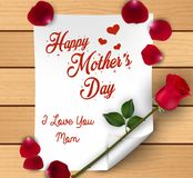 Happy Mothers Day with flowers roses and petals over paper on wooden background Royalty Free Stock Images