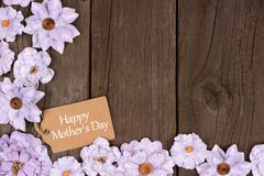 Happy Mothers Day gift tag with flower corner border over wood Royalty Free Stock Images