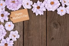 Happy Mothers Day gift tag with flower corner border over wood Royalty Free Stock Photos