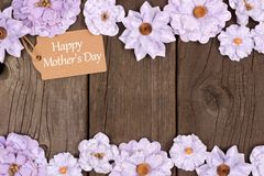 Happy Mothers Day gift tag with flower double border over wood Stock Photography