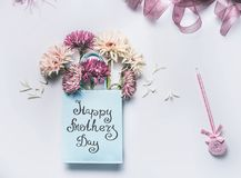 Happy Mothers day! Greeting card with fresh lovely flowers bunch in blue paper shopping bag stock photos