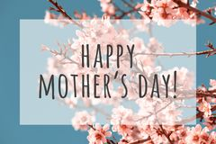 Happy mothers day. Text on blurred flowers background royalty free stock images