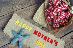 Happy mothers day, i love mom. Happy mothers day with i love you mom message, idea from colorful fabric starfish on wooden background, beautiful flower, abstract stock photo