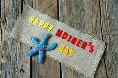 Happy mothers day, i love mom. Happy mothers day with i love you mom message, idea from colorful fabric starfish on wooden background, beautiful flower, abstract stock photography