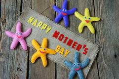 Happy mothers day, i love mom. Happy mothers day with i love you mom message, idea from colorful fabric starfish on wooden background, beautiful flower, abstract stock photos