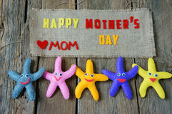 Happy mothers day, i love mom. Happy mothers day with i love you mom message, idea from colorful fabric starfish on wooden background, beautiful flower, abstract royalty free stock image