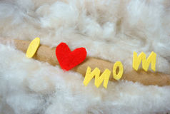Happy mothers day, i love you mom. Message, idea from colorful fiber letter, red heart on white cotton background, abstract concept, mother's day is special day stock image
