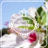 Happy Mothers Day lettering on blurry floral Royalty Free Stock Photo