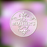 Happy Mothers Day lettering on blurry floral Royalty Free Stock Image