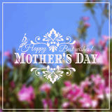 Happy Mothers Day lettering on blurry floral Royalty Free Stock Photography