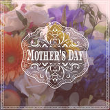 Happy Mothers Day lettering on blurry floral Stock Photography