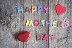 Happy Mothers Day message on old wooden background. Top view royalty free stock image