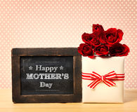 Happy Mothers Day message with roses and present box Stock Photography