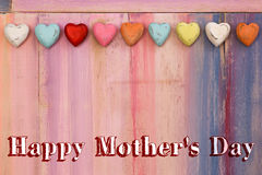 Happy Mothers Day Painted Board with Hearts Stock Photos