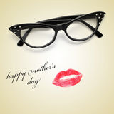 Happy mothers day. A pair of glasses and a lipstick mark forming a woman face and the sentence happy mothers day Royalty Free Stock Photography