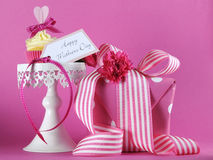 Happy Mothers Day pink heart cupcake on white cupcake stand with gift Stock Images