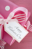 Happy Mothers Day pink polka dot gift. Stock Photo