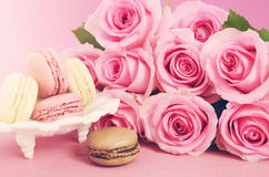 Happy Mothers Day Pink Roses and Macarons. Stock Photos