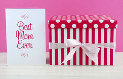 Happy Mothers Day pink and white gift with greeting card. Royalty Free Stock Photos